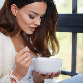 woman eating soup
