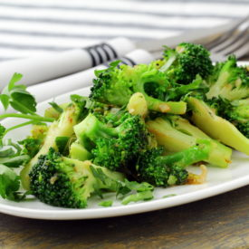 Broccoli on a plate with utensils
